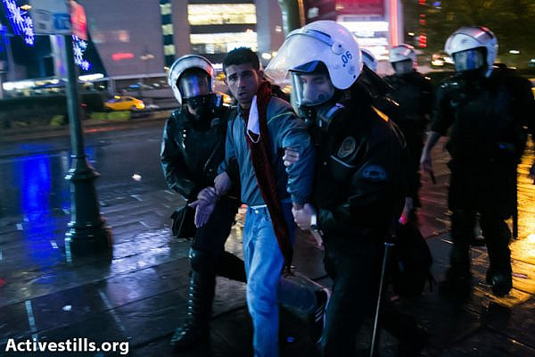 Turkish policemen arrest protesters during clashes following an anti government demonstration, near Kizilay square, Ankara on June 5, 2013.