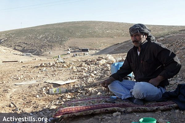 A Bedouin man looking over the ruins of his demolished home. [illustrative photo], (Anne Paq/Activestills)
