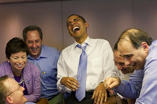 U.S. President Barack Obama laughing aboard Air Force One (Pete Souza/White House Photo, cropped)