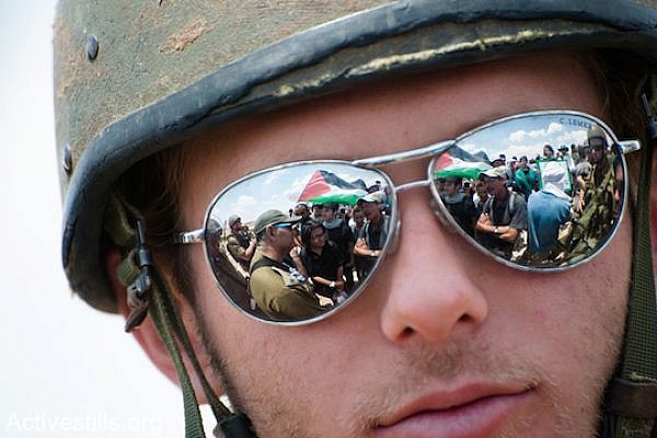 An IDF soldier wearing sunglasses at a demonstration in the south Hebron Hills [file photo], (Ryan Rodrick Beiler / Activestills.org)