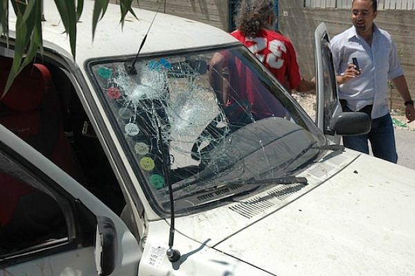 A car belonging to one of the Yesh Din personnel after it was attacked by settlers at Havat Gilad (photo: Yesh Din)
