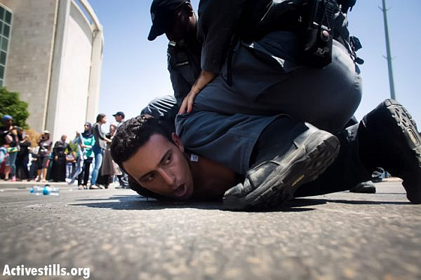 Israeli riot policemen arrest a protester as a few hundred Bedouin accompanied by activists from other parts of the country demonstrate against the Prawer Plan on July 15, 2013, Beer Sheva, Israel. Israeli police arrested 14 protesters during the demo. (photo: Oren Ziv/Activestills.org)