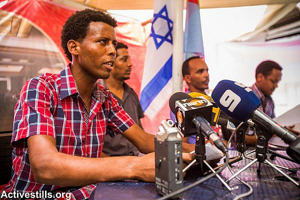 Eritrean activists speaking at the press conference, Tel aviv, July 28, 2013. (Yotam Ronen/Activestills.org)