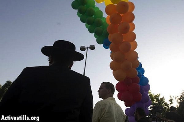 Transgender person dressed as ultra-Orthodox man at Jerusalem Pride Parade, June 26, 2008 (Oren Ziv/Activestills.org)