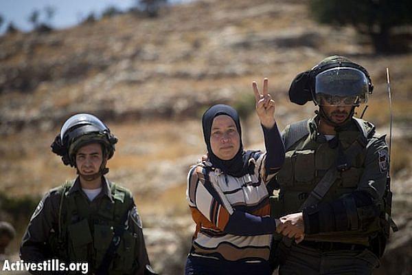 IDF arrests Nariman Tamimi at Nabi Saleh weekly protest June 28, 2013 (Activestills)