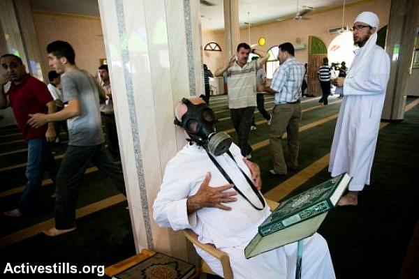 Tear gas in the Qadum mosque (Activestills)