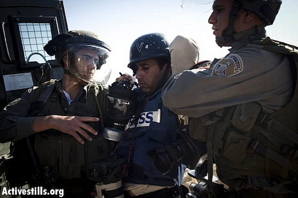 Israeli border policemen arrest AP photographer, Majdi Mohammed, during a protest against the Israel occupation in the West Bank village of Nabi Saleh, December 2, 2011. (Oren Ziv/ Activestills.org)
