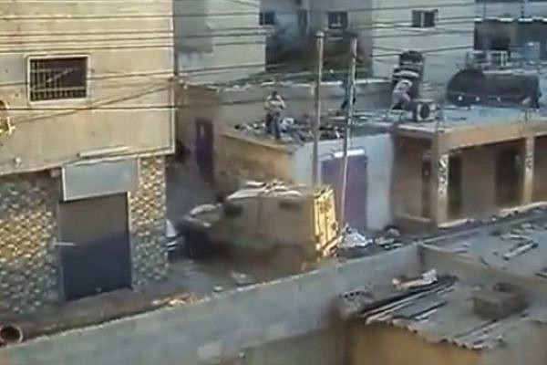 Army vehicle attacked with stones in Qalandia, 26.8.2013 (youtube)