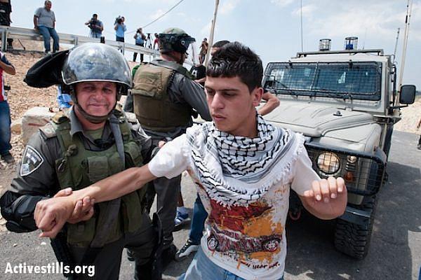Israeli forces arrest a Palestinian youth in the village of al Walaja (Ryan Rodrick Beiler/Activestills.org)