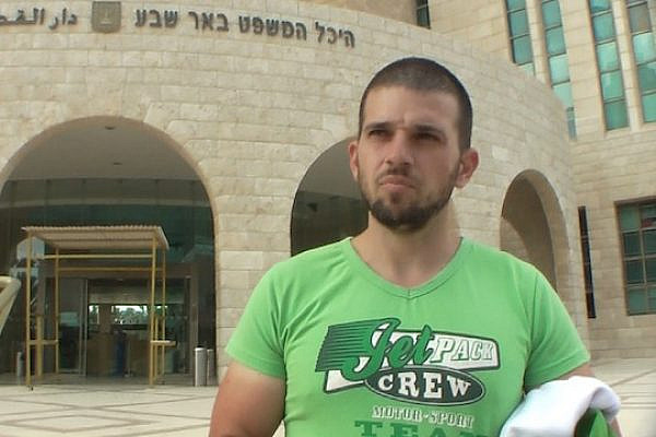 Ido Naveh exits the Be'er Sheva court after being released on October 4, 2013. (Photo: David Sheen)