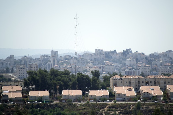 A view of the Israeli settlement of Beit El with the neighboring Palestinian city of Ramallah in the background. (Photo: Michael Omer-Man)