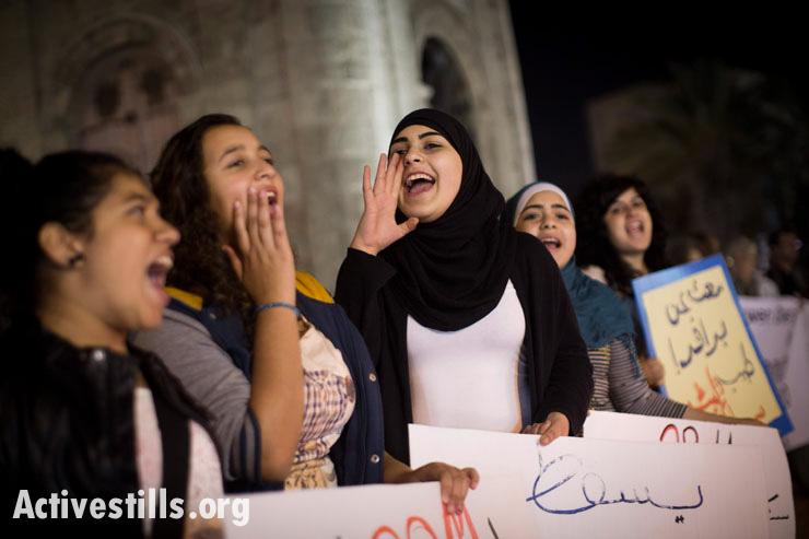 Palestinians citizens of Israel shout slogans during a protest against the Prawer Plan, Jaffa, November 21, 2013. (Oren Ziv/Activestills.org)