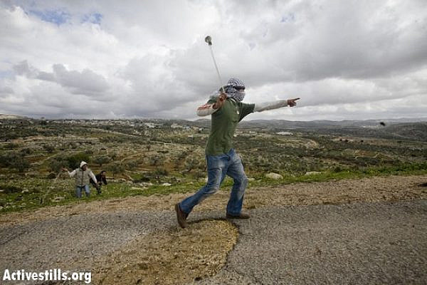 Illustrative photo of a Palestinian youth throwing stones. (Photo: Activestills.org)