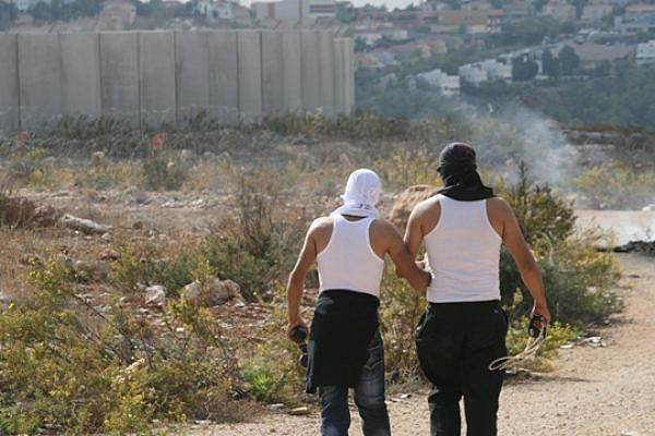Hand in hand. Bil'iners and the wall (Haggai Matar)