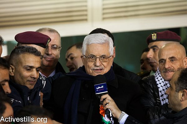 Palestinian President Mahmoud Abbas addresses released Palestinian prisoners at his headquarters in the West Bank city of Ramallah on December 31, 2013. (Activestills.org)