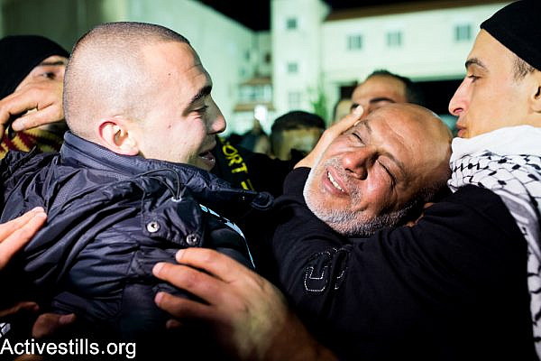 Freed Palestinian prisoners are greeted as they arrive at the Mukata Presidential Compound in the early hours on December 31, 2013 in Ramallah, West Bank.  (Activestills.org)