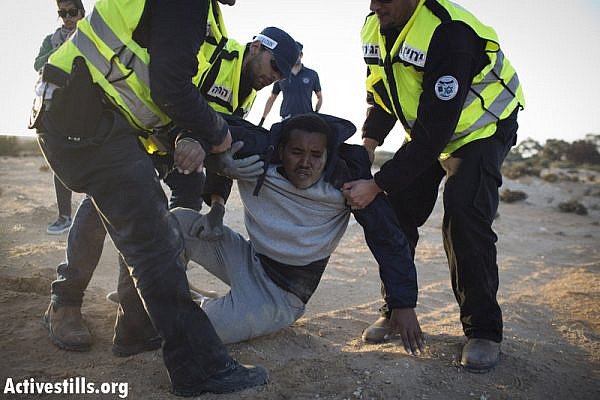 African asylum seeker getting arrested after marching during a second March For Freedom, from Holot detention centre towards Beer Sheva, Negev, December 19, 2013. (Activestills.org)
