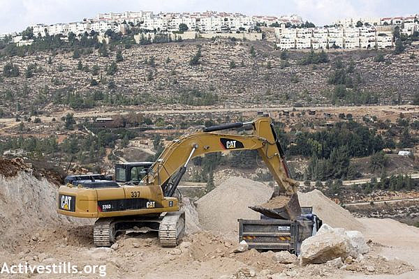 Construction on a road ostensibly connecting the Cremisan Monastery to Jerusalem threatens to uproot olive trees belonging to Hisham Abu Ali and other residents of al-Walaja, West Bank. (Anne Paq/Activestills.org)