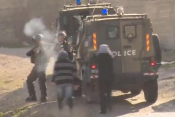 Israeli forces shoot Manal Tamimi from close range in Nabi Saleh, Dec 27, 2013 (photo: Screenshot)
