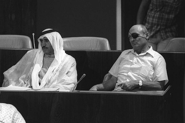 Then MK Moshe Dayan and Bedouin MK Sheikh Hamad Abu Rabia in the Knesset, September 3, 1975. (Photo: Moshe Milner/GPO)