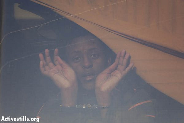 "An asylum seeker detained by immigration police during the second ""March for Freedom."" (photo: Oren Ziv/Activestills.org)"