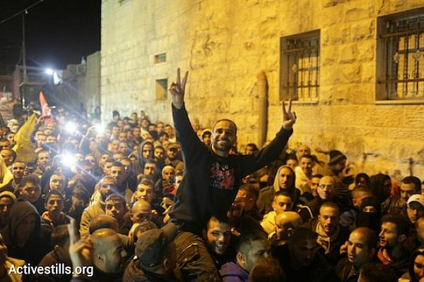 Former Palestinian hunger striker Samer Issawi arrives home in his East Jerusalem village of Issawiya, December 23, 2013. Issawi secured his freedom after staging an intermittent hunger strike for nearly nine months. (Photo: Oren Ziv/Activestills.org)