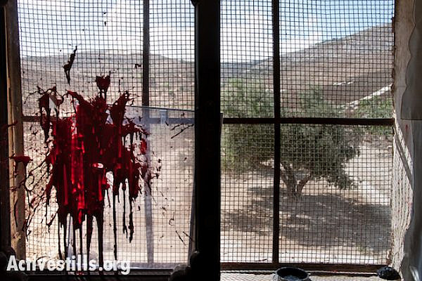 Red paint thrown during an attack by Israeli settlers on a Palestinian home in the West Bank village of Burin, October 9, 2012. (Photo: Ryan Rodrick Beiler/Activestills.org)