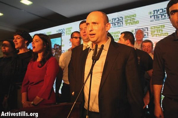 Naftali Bennett and Ayelet Shaked of Jewish Home at the party headquarters on election day 2013 (Activestills)