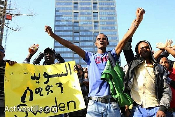 Thousands of African refugees protest in front of German, Swedish, US and Canadian embassies calling the international community to support their struggle against Israel's asylum policies. (photo: Yotam Ronen/Activestills.org)