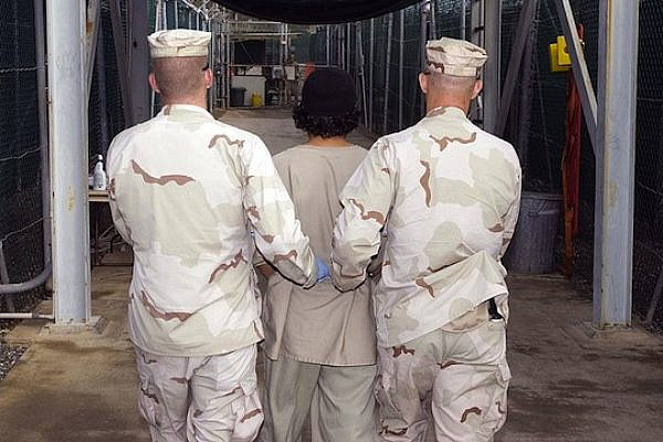 JTF Guard Force Troopers transport a Guantanamo detainee to the detainee hospital located adjacent to Camp Four, Dec. 27, 2007. (photo: Navy Petty Officer 1st Class Michael Billings)