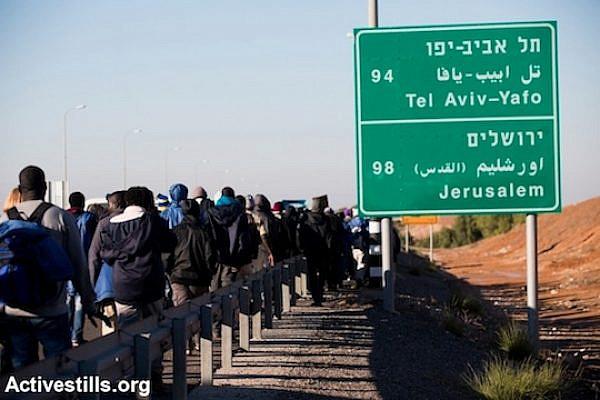 African Asylum seekers march out of the Holot 'open prison,' where they were being held, and march along the highway from Beer Sheva in southern Israel on their way to Jerusalem, December 16, 2013. (Photo: Activestills.org)