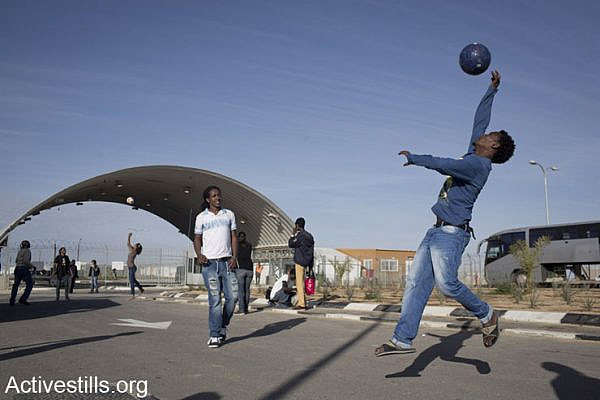 African asylum seekers held in the Holot detention center play outside as asylum seekers living in Tel Aviv and  Israeli activists held a solidarity visit, January 25, 2014. (photo: Oren Ziv/Activestills.org)