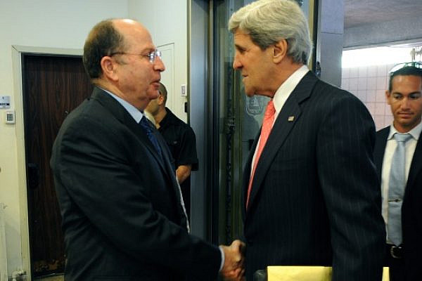 U.S. Secretary of State John Kerry is welcomed by Israeli Defense Minister Moshe Ya'alon in Jerusalem on May 23, 2013. (State Dept Photo)