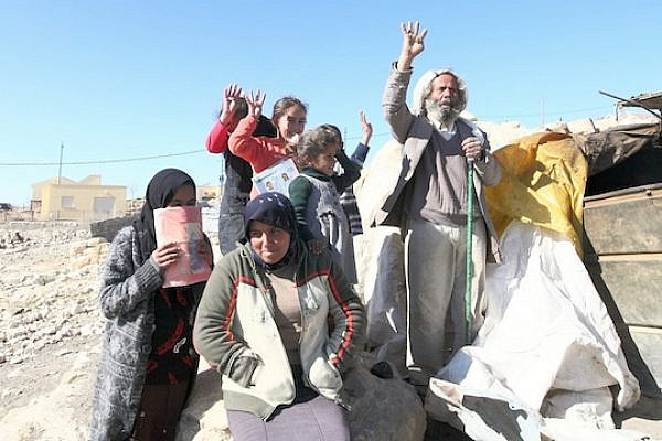 Residents of Umm Al Khir near the taboun. (Photo by Yossi Gurvitz)