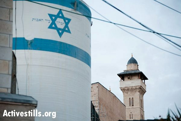 An Israeli settlement water tank stands near the Ibrahimi Mosque or Tomb of the Patriarchs in the West Bank city of Hebron.