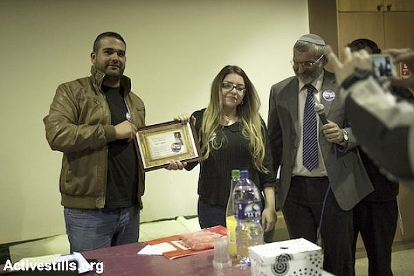 "Sapir Sabah receives the ""Jewish State"" award, during a ceremony organized by  former MK Michael Ben-Ari , Kiryat Tivon, February 9, 2014. (Activestills.org)"