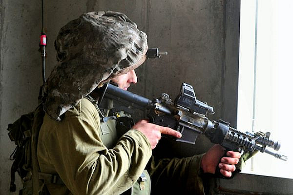 Illustrative photo of an IDF sharpshooter aiming his weapon (Photo by ChameleonsEye / Shutterstock.com)