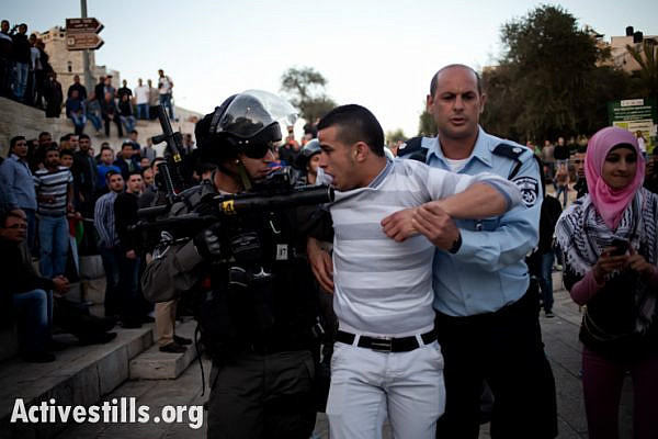 A Palestinian protester arrested by Israeli border police during clashes at Damascus Gate, during a solidarity protest with Jenin Refugee Camp, East Jeruslaem, on March 22, 2014. Dozens of Palestinians protested in Jerusalem against the killing of three Palestinians in Jenin refugee camp. Six protesters were arrested.