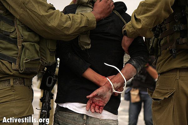 Israeli soldiers arresting a Palestinian man, September 27, 2008. (Photo by Anne Paq/Activestills.org)