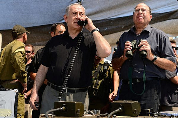 Israeli Prime Minister Benjamin Netanyahu and Defense Minister Moshe Ya'alon survey a military exercise. (Photo by GPO/Kobi Gideon)