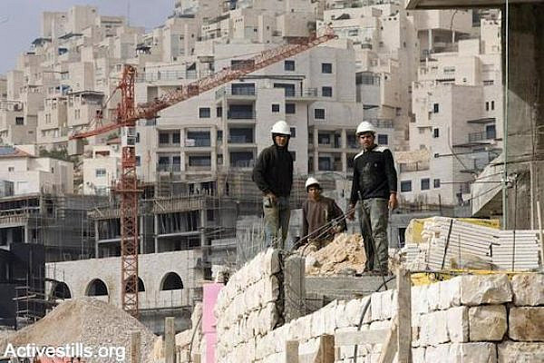 Palestinian construction workers in an Israeli settlement (Photo by Yotam Ronen/Activestills.org)
