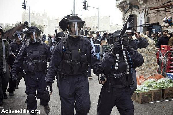 Israeli police dispersing a march in Damascus Gate, held to mark Land Day, which commemorates the killing of six Palestinians in Sakhnin in 1976, during a protest against land expropriation. (Photo by JC/Activestills.org)