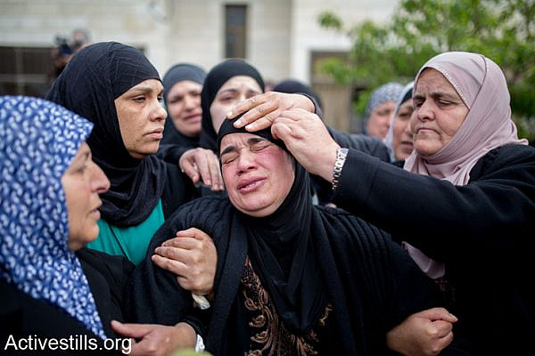 The mother of of Saji Sayel Darwish who was shoot last night by Israeli soldier on a road to Ramallah on March 11, 2014 in Beitin, West Bank. According to media reports the family rejects Israeli military claims alleging he threw stones at settlers' vehicles, and that such claims are only meant to justify the cold-blooded murder of their son.