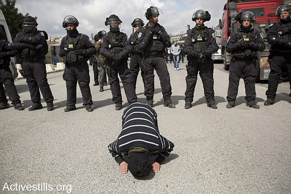 Palestinians pray outside Al-Aqsa Mosque after Israeli police limited access to the mosque for young worshipers to prevent possible clashes, Ras al-Amud, East Jerusalem, March 14, 2014. (photo: Activestills.org)