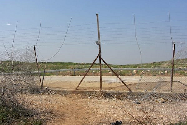 Gap in fence where 14-yr old Yusef a-Shawamreh was killed by IDF fire while crossing (Itamar Barak, B'Tselem)