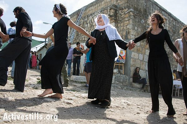 On Easter Monday in the displaced Palestinian village of Iqrit, residents dance around the town's church, April 21, 2014. (Activestills.org)