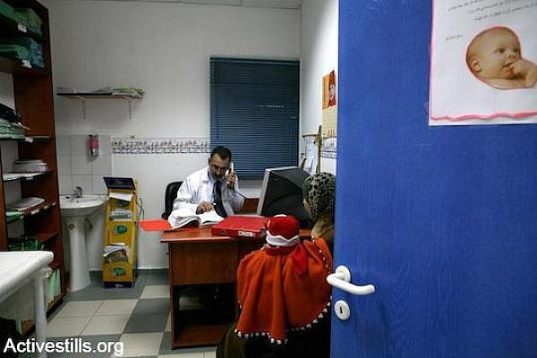 A Palestinian doctor at a clinic in the East Jerusalem neighborhood of Silwan. (Photo by Activestills.org)