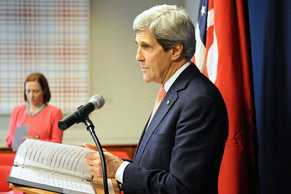 File photo of U.S. Secretary of State John Kerry, with State Department Spokesperson Jen Psaki in the background, conducting a press conference, February 18, 2014.(Photo: State Dept.)