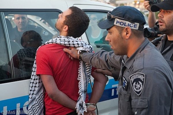 Police arrest a Palestinian citizen of Israel during a 2012 protest in Ramle. (photo: Mati Milstein)