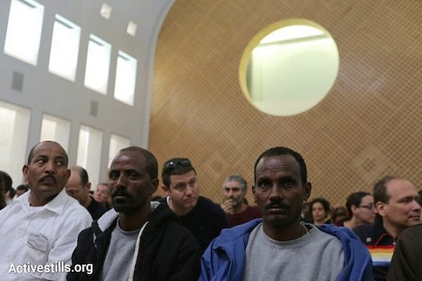 """Asylum seekers at the High Court of Justice for a hearing on the revised """"Anti-Infiltration Law"""", April 1, 2014. (Photo by Activestills.org)"""